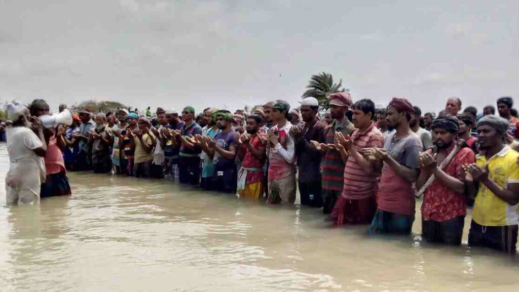 namaz in river by muslims on eid in bangladesh